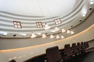 Circular office with pendant lights.
