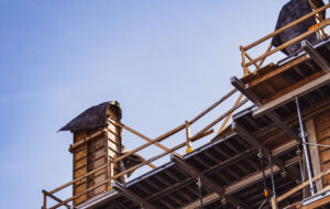 Urban construction site agains blue sky.